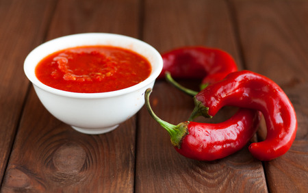gazpacho: Tomato sauce in a white tank and hot red chili pepper.