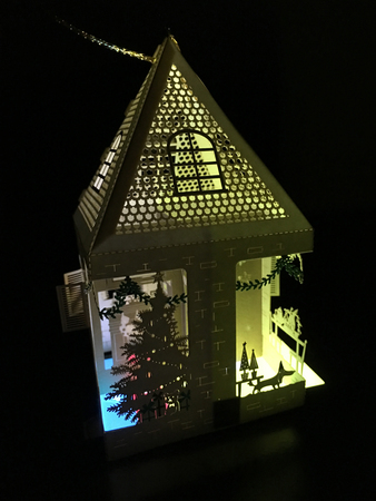 lit up 3d holiday paper house with a christmas tree laser cut ornament decoration greeting card