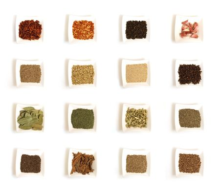 Various kinds of spices - bird eye chili pepper, crushed chili pepper, whole black pepper, garlic, cumin, coriander, white poppy seeds, whole cloves, bye leaves, dried dill, cardamon, dried thyme, black cumin, cinnamon, dill seeds, black coriander