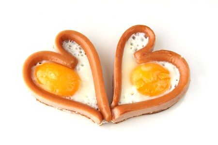 bacon love: heart sausages with fried eggs for lovely breakfast