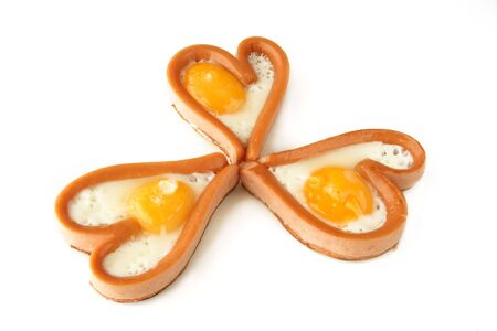 heart sausages with fried eggs for lovely breakfast  for Valentines day or weekend photo