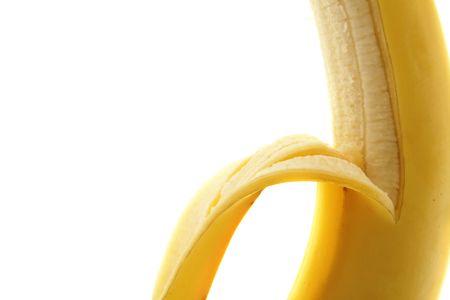 close-up half peeled banana on white background photo