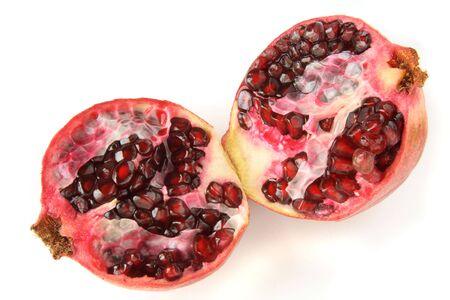 pommegranates: two halfs  of dark ruby pomegranate clouse-up