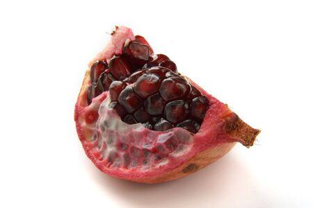 pommegranates: quarter of dark ruby pomegranat clouse-up Stock Photo