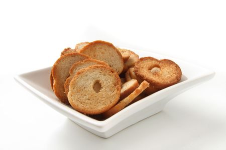 mini baked bread chips in square bowl photo