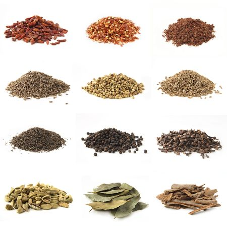 Various kinds of spices - bird eye chili pepper, crushed chili pepper, pomegranate powder  cumin, white coriander,dill seeds,black cumin, whole black pepper, whole cloves, cardamon,bye leaves,cinnamon photo