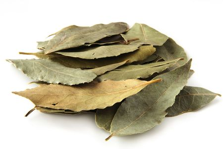 dried bay leaves in pale on white background photo