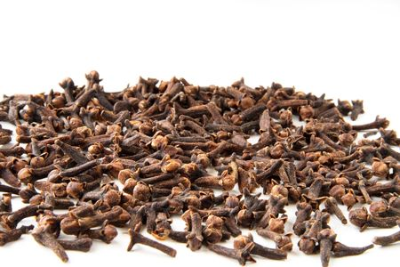 whole cloves spices on white background photo