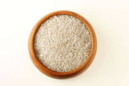 raw rice in a wooden bowl Stock Photo