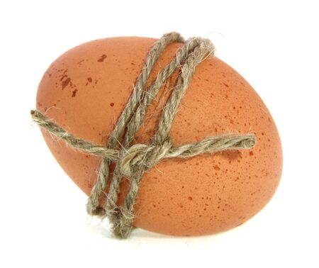 dozen: brown egg tied by rope, isolated, no shadow