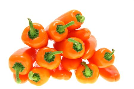 stacked orange bell pointed peppers,  close-up, soft focus, white background, no shadow Banque d'images