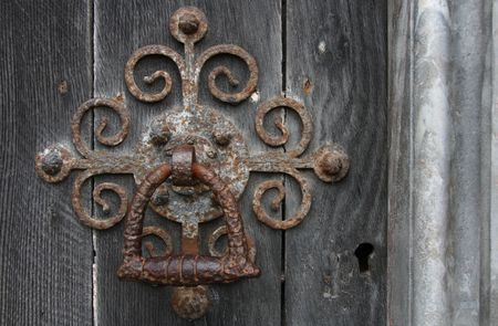 The door handle on an medieval door of a masive old chirch photo