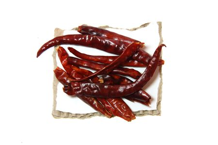 torn edges: Spice Red Hot Chilli pepper on pieces of paper with torn edges, isolated on white Stock Photo