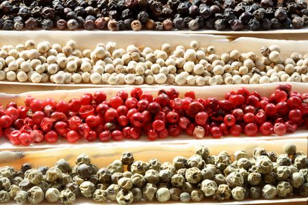 peppercorns: Peppercorns Spices in the sea shells - Black peppercons, Green peppercons, Red peppercons, White  peppercons Stock Photo