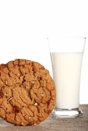 shallow dof: milk glass with toffee pecan cookie on burlap canvas, Shallow dof.