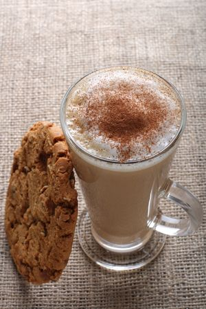 Cafe Coffee - Latte Cappuccino in a tall glass with pecan nut and toffee cookies photo
