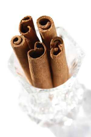 cutglass: cinnamon sticks in a  crystal glass, top view, light shadow