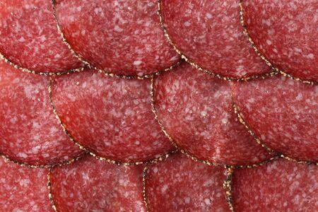 pepper salami: german pepper salami sausage, sliced, background Stock Photo