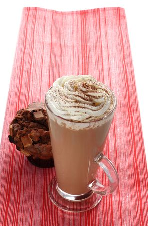 tall cup of fresh coffee latte cappucino and chocolate muffin on the red tea towel Stock Photo - 2733369