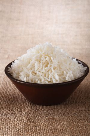basmati: plain white rice bowl  on brown rustic background, Low Key Lighting Technique, Shallow DOF