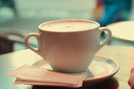 coffee hour: large cup of coffee in retro style colors, special retro style ligth effect. shallow DOF Stock Photo