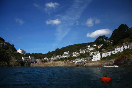 devon: view from the sea on Fishing village of Polperro in Cornwall, England