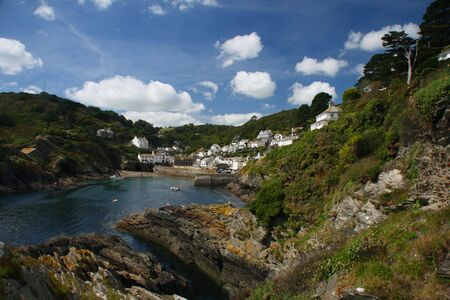 cornwall: view from the cliffs on harbor and Fishing village of Polperro in Cornwall, England Stock Photo
