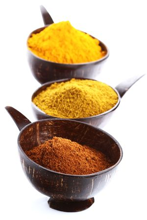 spices - pile of bright Madras Curry Powder and 2 bowls behind, shallow DOF