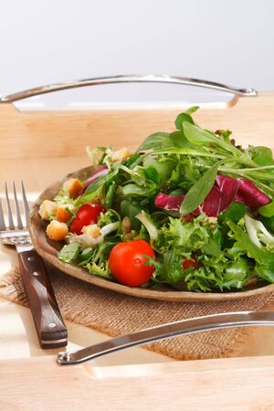 serving tray: green leaves salad on serving tray Stock Photo