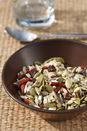 mixed seeds cereal for healthy breakfast or snacking photo
