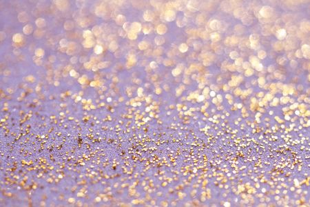 golden glitter sparkles dust background, shallow DOF Stock Photo