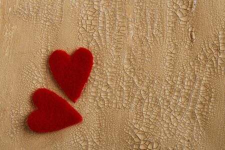 two fluffy hearts on cracked painted background photo
