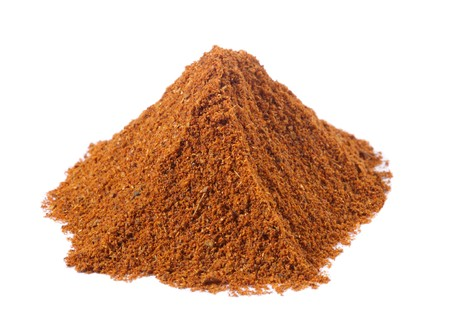 spices - pile of tandoori masala over white photo