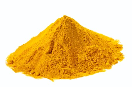 turmeric: spices - pile of Yellow Turmeric over white