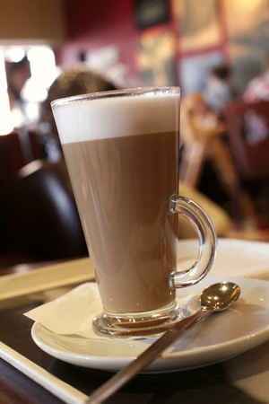 tall glass: Coffee latte in a tall glass, Cafe background, shallow DOF