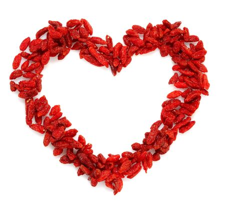 lycium: GOJI berryes heart shape, bright red color, over white