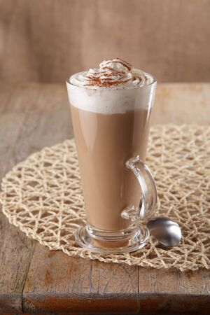 coffee latte macchiato with cream in glass on old table background, shallow DOF Stock Photo - 4640875