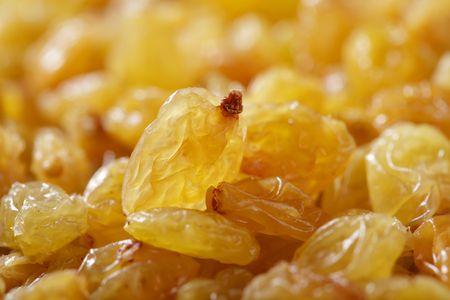 sultanas: golden sultanas raisins background closeup, shallow DOF