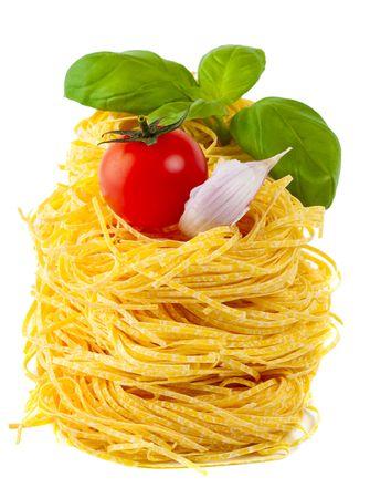 pasta, tomato, basil, garlic - ingredients for italian cooking, over white photo