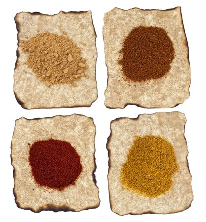 paprika, ginger, curry, tikka masala powders on old paper isolated photo