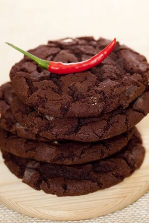 chocolate chip american style cookies stacked red hot chilli on the top, shallow DOF Stock Photo - 5263905