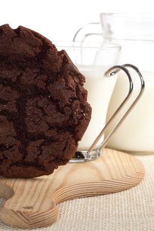 chocolaty: chocolaty cookie and some milk on background, shallow DOF