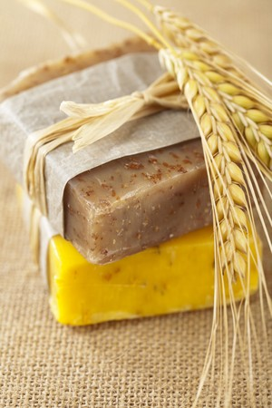 homemade soap bars with wheat spikelets, shallow DOF, super macro photo