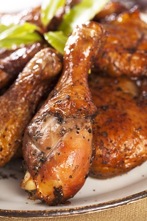 chicken leg: homemade smoked  chicken drumstick on a plate, shallow DOF