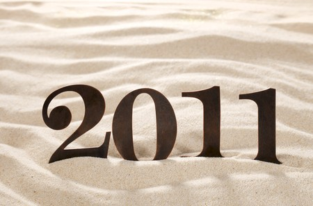 2011 new year metal numbers on beach sand, shallow DOF photo