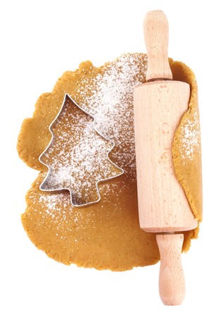 christmas gingerbread tree cookie cutter on dough with rolling pin, isolated on white Stock Photo - 8139690