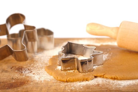 christmas gingerbread tree cookie cutter on dough with rolling pin,white backdrop photo