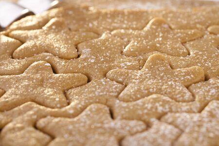gingerbread  star cookie cuts dough, shallow dof photo