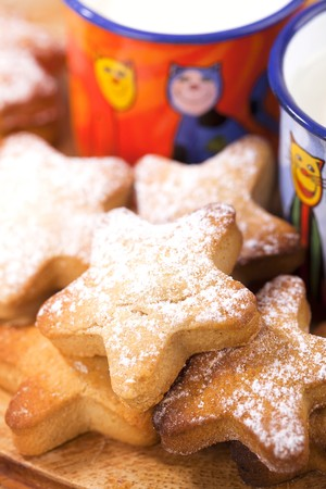 homemade gingerbread  star cookies with kids milk, shallow dof photo