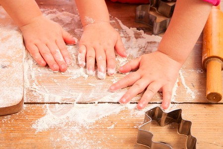 little girls baking and having fun, hands only photo
